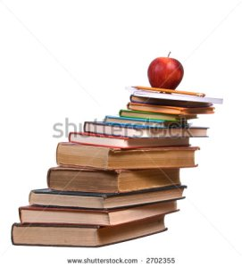 books-stacked-sky-high-and-about-to-fall-too-much-homework-2702355